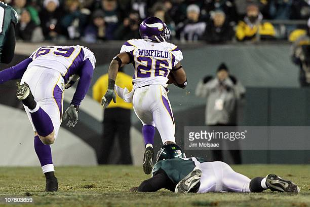Antoine Winfield of the Minnesota Vikings returns a fumble for a touchdown against Michael Vick of the Philadelphia Eagles in the first half at...