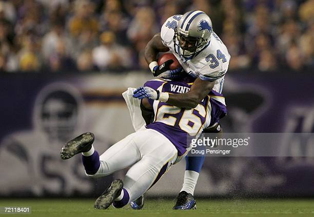 Antoine Winfield of the Minnesota Vikings tackles Kevin Jones of the Detroit Lions October 8 2006 at the Metrodome in Minneapolis Minnesota