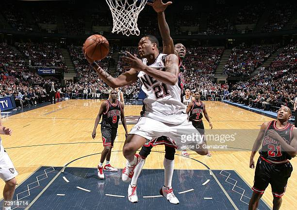 Antoine Wright of the New Jersey Nets shoots against Ben Wallace of the Chicago Bulls on April 18 2007 at the Continental Airlines Arena in East...