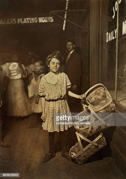Antoinette Siminger 12 years old Selling Baskets at Sixth Street Market at 1000 pm FullLength Portrait Cincinnati Ohio USA Lewis Hine for National...