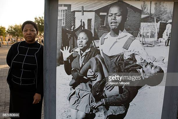 Antoinette Sithole sister of Hector Peterson who was murdered by South African police thirty years ago poses alongside the iconic image by Sam Nzima...