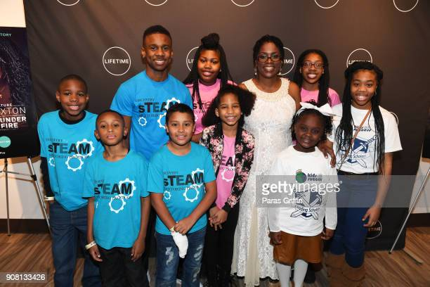 """Antoinette Tuff pose with volunteers at """"Faith Under Fire: The Antoinette Tuff Story"""" red carpet screening at Woodruff Arts Center on January 20,..."""