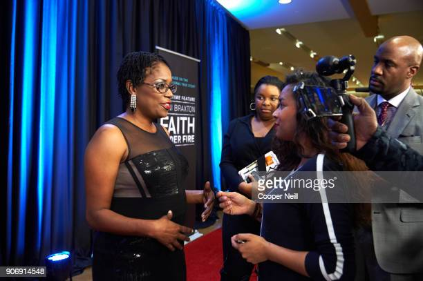 """Antoinette Tuff speaks with the press during the premiere of """"Faith Under Fire: The Antoinette Tuff Story"""" at the Potter's House on January 18, 2018..."""