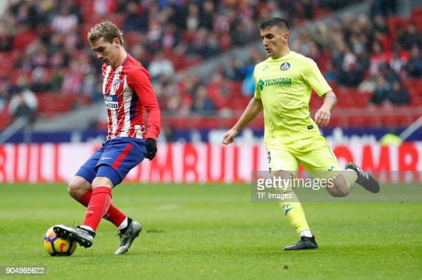 Antoinne Griezmann of Atletico Madrid and Arambarri of Getafe battle for the ball during the La Liga match between Atletico Madrid and Getafe at...