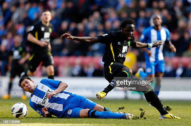 Antolin Alcaraz of Wigan in action with Kei Kamara of Norwich during the Premier League match between Wigan Athletic and Norwich City at the DW...