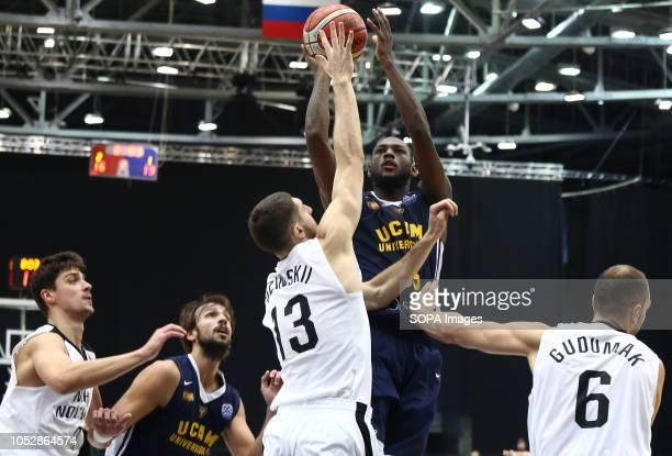 Anton Astapkovich Dmitrii Uzinskii Aleksandr Gudumak and Alex Urtasun Miton Doyle seen in action during the game Basketball Champions League BC...