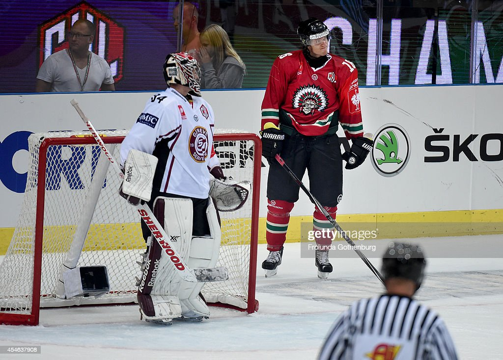 Anton Axelsson #16 reacts after missing a goal against goalie Gauthier Descloux #34 of Geneve-Servette during the Champions Hockey League group stage game on September 4, 2014 in Gothenburg, Sweden.