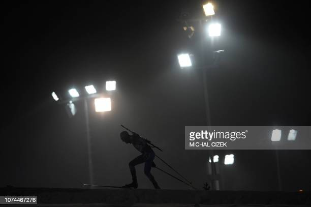 TOPSHOT Anton Babikov of Russia competes during the Men's 10Km sprint competition of IBU World Cup Biathlon in Nove Mesto Czech Republic on December...