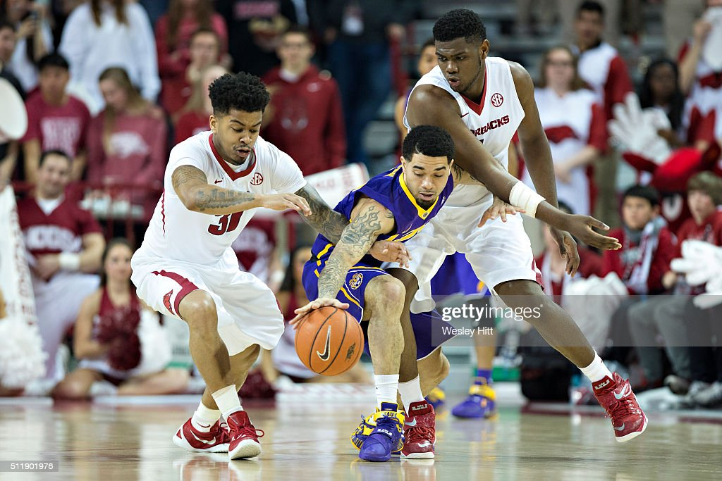 Anton Beard #31 and Trey Thompson #1 of the Arkansas Razorbacks goes after a loose ball against Josh Gray #5 of the LSU Tigers at Bud Walton Arena on February 23, 2016 in Fayetteville, Arkansas.