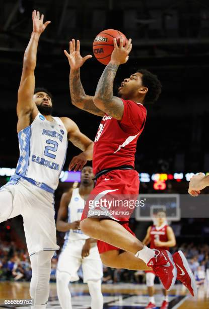 Anton Beard of the Arkansas Razorbacks drives to the basket against Joel Berry II of the North Carolina Tar Heels in the second half during the...