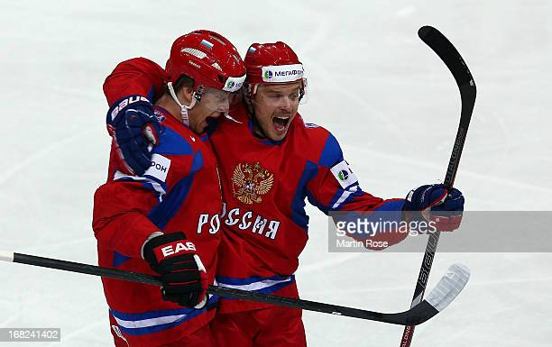 Anton Belov of Russia celebrate with team mate Denis Denisov after he score shi steam's opening goal during the IIHF World Championship group H match...
