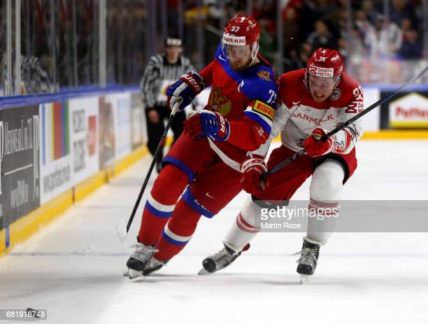 Anton Belov Russia challenges Morten Poulsen of Denmark for the puck during the 2017 IIHF Ice Hockey World Championship game between Russia and...