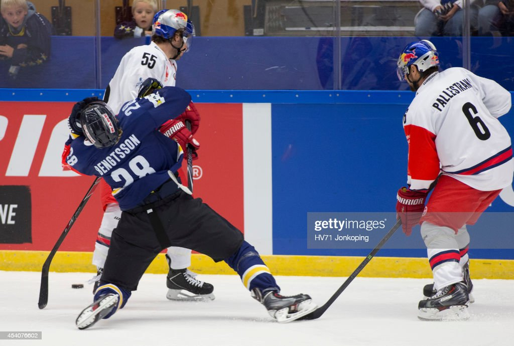 Anton Bengtsson #28 of HV71 get's a stick in the face from David Meckler #55 of Red Bull Salzburg during the Champions Hockey League group stage game between HV71 Jonkoping and Red Bull Salzburg on August 24, 2014 in Jonkoping, Sweden.