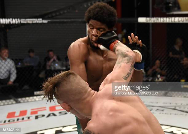 Anton Berzin of Ukraine punches Kennedy Nzechukwu in their light heavyweight bout during Dana White's Tuesday Night Contender Series at the TUF Gym...