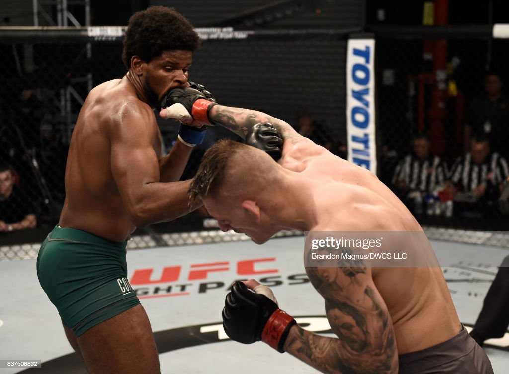 Anton Berzin of Ukraine punches Kennedy Nzechukwu in their light heavyweight bout during Dana White's Tuesday Night Contender Series at the TUF Gym on August 22, 2017 in Las Vegas, Nevada.
