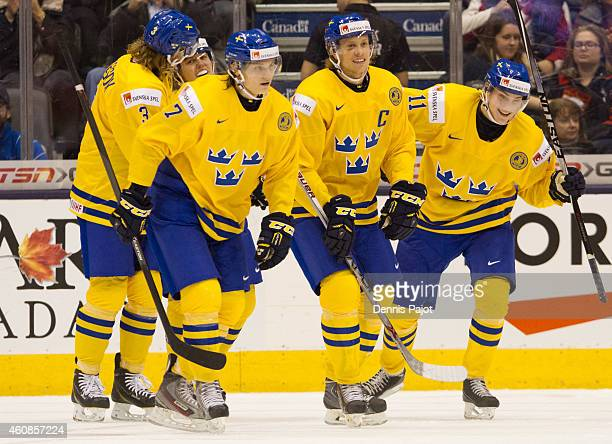 Anton Blidh of Sweden celebrates a goal against Denmark during the 2015 IIHF World Junior Championship on December 27 2014 at the Air Canada Centre...