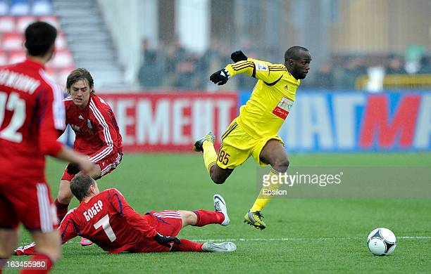 Anton Bober of FC Mordovia Saransk is challenged by Lassana Diarra of FC Anzhi Makhachkala during the Russian Premier League match between FC...