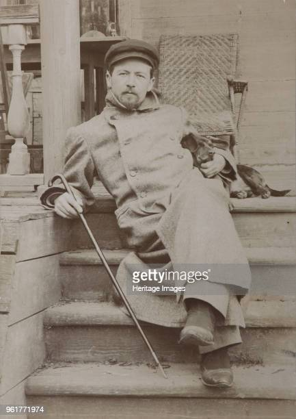Anton Chekhov with dog Hina Melikhovo 1897 Found in the Collection of State Central Literary Museum Moscow