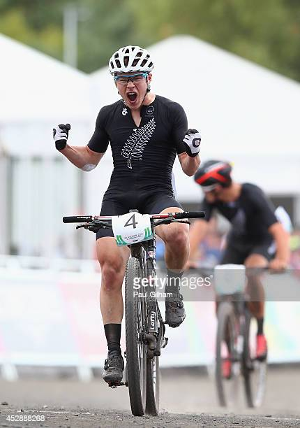 Anton Cooper of New Zealand celebrates as he crosse the finish line to win the Gold Medal ahead of his teammate Samuel Gaze of New Zealand in the...