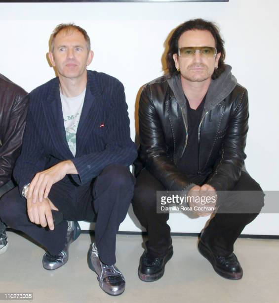 Anton Corbijn and Bono during Anton Corbijn's 'U2 I' Opening at the Stellan Holm Gallery at Stellan Hom Gallery in New York City New York United...