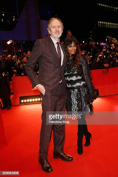 Anton Corbijn and Nimi Ponnadurai attend the 'Hail Caesar' premiere during the 66th Berlinale International Film Festival Berlin at Berlinale Palace...