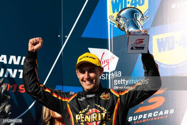 Anton de Pasquale driver of the Penrite Racing Holden Commodore ZB celebrates on the podium during the Phillip Island 500 as part of the Supercars...