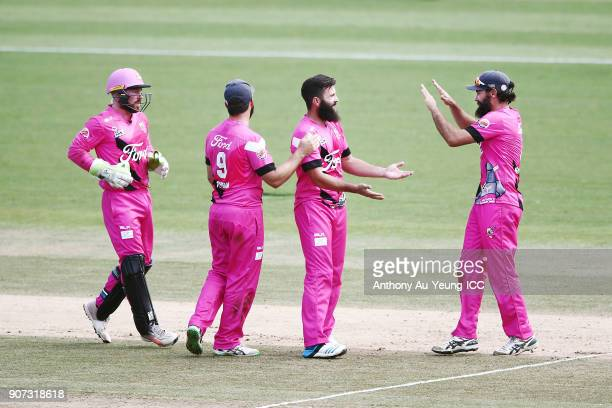 Anton Devcich of the Knights celebrates with teammates for the wicket of Ben Wheeler of the Stags during the Super Smash Grand Final match between...