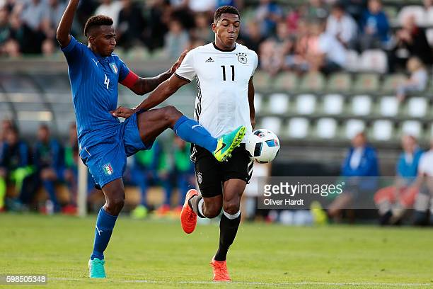 Anton Donkor of Germany and Elio Capradossi of Italy compete for the ball during the international friendly match between U20 Germany and U20 Italy...