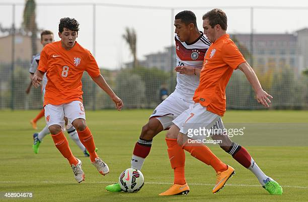 Anton Donkor of Germany challenges Gustavo Harner and Martijn Berden of Netherlands during the international friendly match between U18 Germany and...
