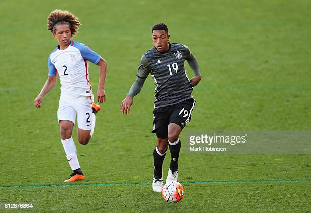 Anton Donkor of Germany goes past Marlon Fossey of USA during the Under 20s Four Nations Tournament match between Germany and the United States at...