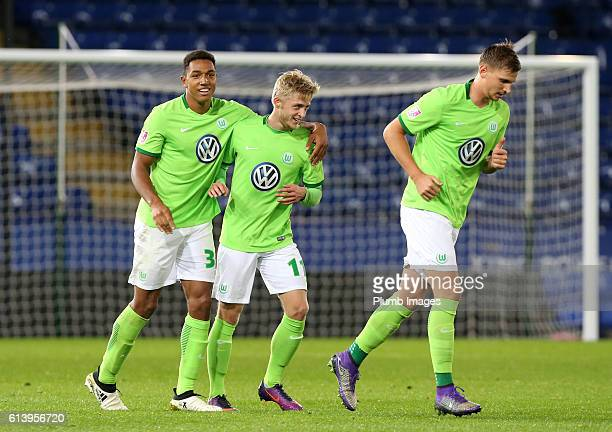 LEICESTER ENGLAND OCTOBER Anton Donkor of VFL Wolfsburg celebrates with Justin Mobius of VFL Wolfsburg after scoring to make it 02 during the Premier...