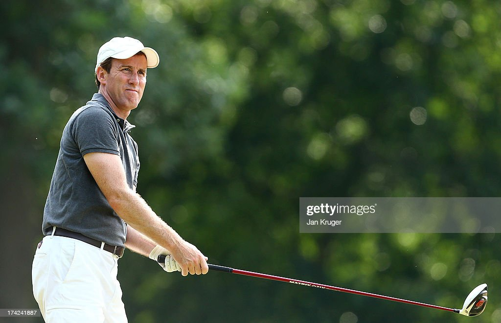 Anton du Beke tees off during the Gary Player Invitational Europe 2013 at Wentworth Golf Club on July 22, 2013 in Virginia Water, England.