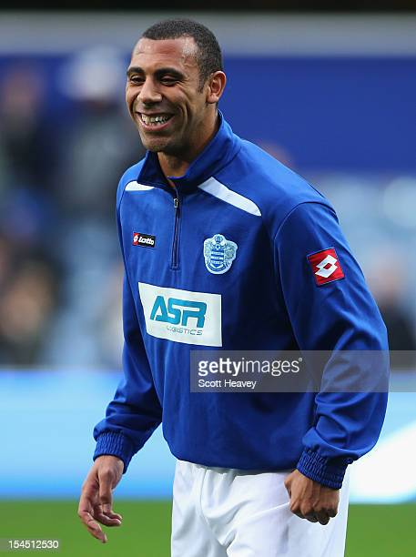 Anton Ferdinand of Queens Park Rangers smiles up as he warms up prior to the Barclays Premier League match between Queens Park Rangers and Everton at...