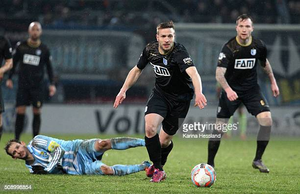 Anton Fink of Chemnitz on the ground Lars Fuchs of Magdeburg on the ball during the Third League match between Chemnitzer FC and 1FC Magdeburg at...