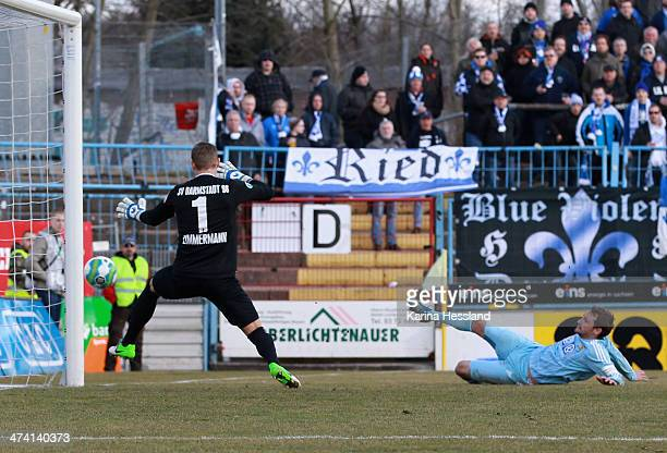 Anton Fink of Chemnitz scores the opening goal Goalkeeper Jan Zimmermann of Darmstadt without a chance during the third Liga match between Chemnitzer...