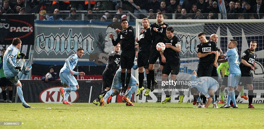 Anton Fink of Chemnitz shoots into the wall of Magdeburg during the Third League match between Chemnitzer FC and 1.FC Magdeburg at Stadion an der Gellertstrasse on February 05, 2016 in Chemnitz, Germany.