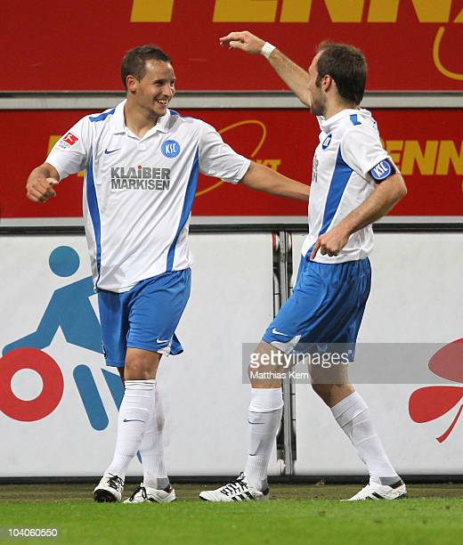 Anton Fink of Karlsruhe jubilates with team mate Alexander Iashvili after scoring the fifth goal during the Second Bundesliga match between FC...