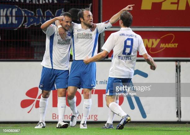 Anton Fink of Karlsruhe jubilates with team mates after scoring the fifth goal during the Second Bundesliga match between FC Energie Cottbus and...