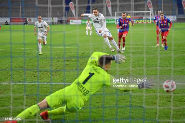 Anton Fink of Karlsruhe scores a penalty against goalkeeper Rene Vollath of Uerdingen during the 3 Liga match between KFC Uerdingen 05 and Karlsruher...