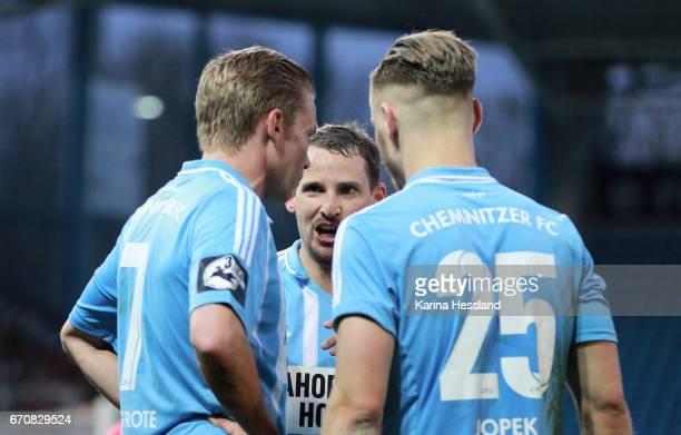 Anton Fink talks to Dennis Grote and Bjoern Jopek of Chemnitz during the Semifinals at Wernesgruener Sachsen Pokal between Chemnitzer FC and FSV...