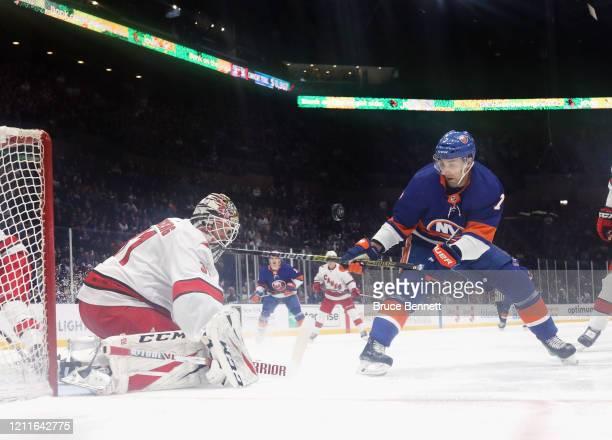 Anton Forsberg of the Carolina Hurricanes makes the save on Jordan Eberle of the New York Islanders at NYCB Live's Nassau Coliseum on March 07 2020...