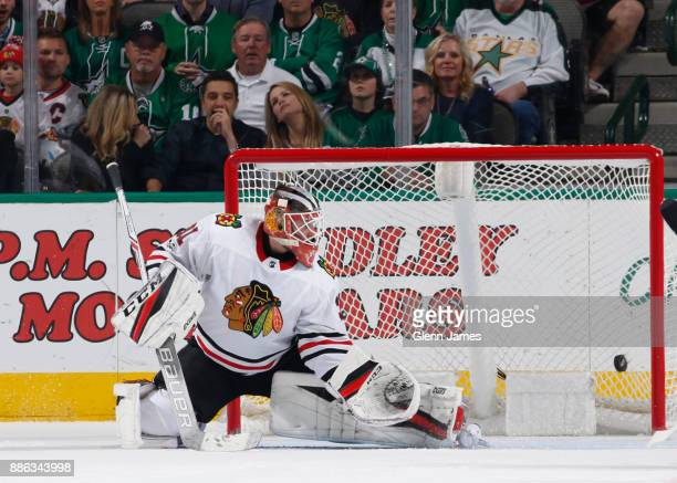 Anton Forsberg of the Chicago Blackhawks has a goal get past him against the Dallas Stars at the American Airlines Center on December 2 2017 in...
