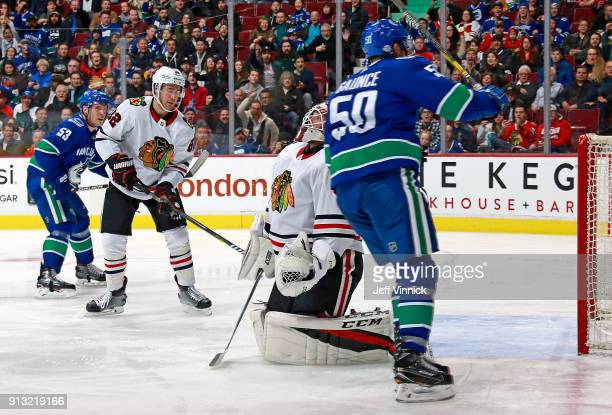 Anton Forsberg of the Chicago Blackhawks looks on as Anders Nilsson of the Vancouver Canucks celebrates after scoring during their NHL game at Rogers...