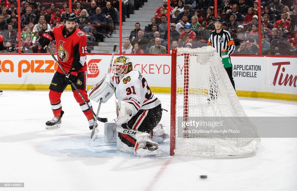 Anton Forsberg #31 of the Chicago Blackhawks makes a pad save as Zack Smith #15 of the Ottawa Senators look for a rebound in the second period at Canadian Tire Centre on January 9, 2018 in Ottawa, Ontario, Canada.