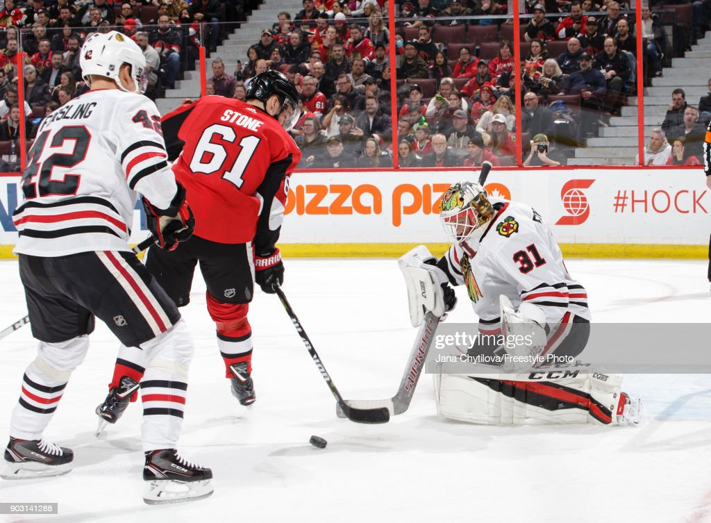 Anton Forsberg #31 of the Chicago Blackhawks makes a save against Mark Stone #61 of the Ottawa Senators as Gustav Forsling #42 of the Chicago Blackhawks looks on in the second period at Canadian Tire Centre on January 9, 2018 in Ottawa, Ontario, Canada.