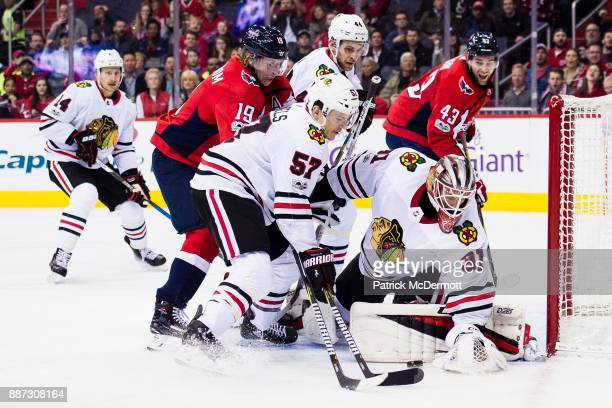 Anton Forsberg of the Chicago Blackhawks makes a save against the Washington Capitals in the first period at Capital One Arena on December 6 2017 in...
