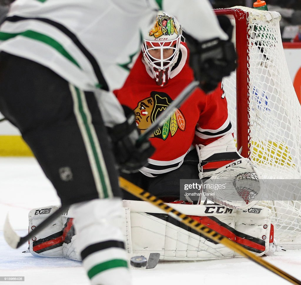 Anton Forsberg #31 of the Chicago Blackhawks stops a shot by Radek Faksa #12 of the Dallas Stars at the United Center on February 8 2018 in Chicago, Illinois.