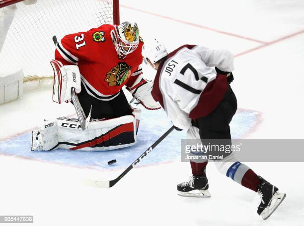 Anton Forsberg of the Chicago Blackhawks stops a shot by Tyson Jost of the Colorado Avalanche at the United Center on March 20 2018 in Chicago...