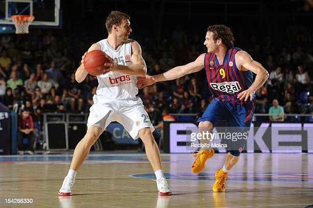 Anton Gavel #25 of Brose Baskets Bamberg competes with Marcelinho Huertas #9 of FC Barcelona Regal during the 20122013 Turkish Airlines Euroleague...
