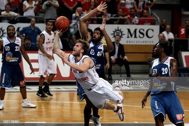 Anton Gavel of Brose Baskets tries to score against Greg Jenkins and Jimmy McKinney of Frankfurt during game five of the Beko Basketball Bundesliga...